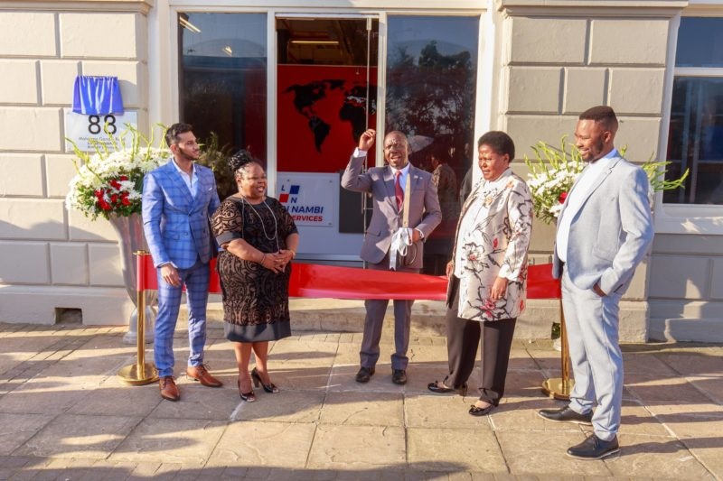 Deputy Director General of Transport Dumisani Ntuli cuts the ceremonial ribbon at the entrance of the Linsen Nambi offices